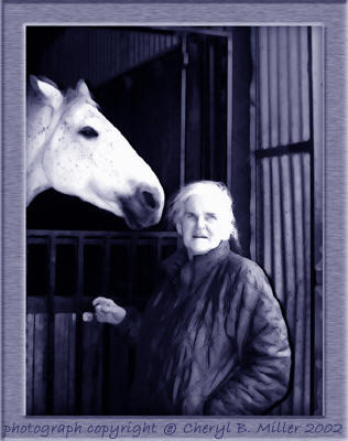 Photo of Anne McCaffrey and horse at Dragonhold Stables © Cheryl Miller 2002